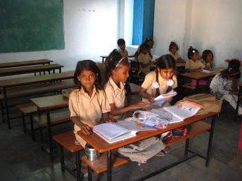 The classrooms are now furnished with desk sets